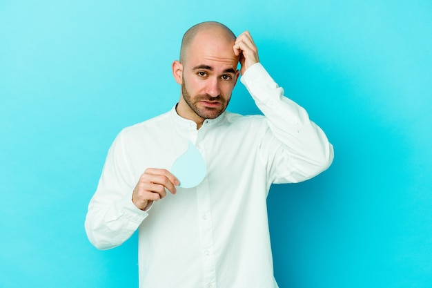 Young caucasian bald man celebrating world water day isolated on blue background being shocked