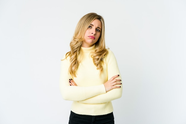 Young caucasian blonde woman unhappy looking in camera with sarcastic expression.