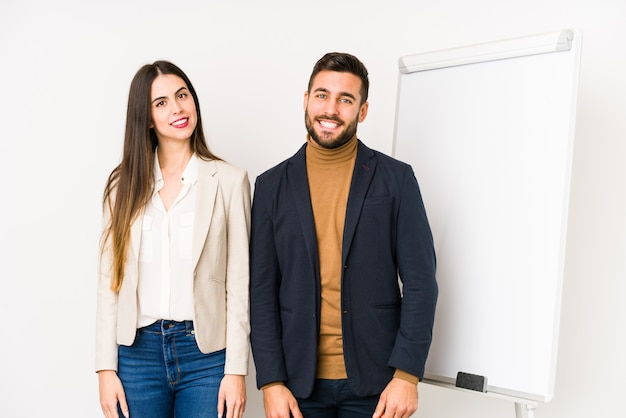 Young caucasian business couple happy, smiling and cheerful.