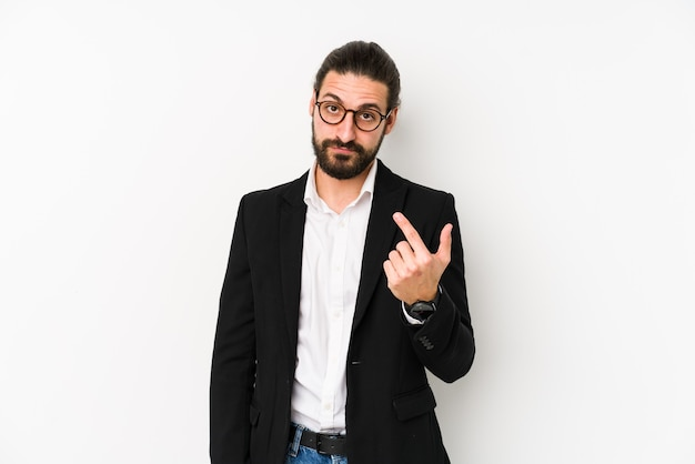 Young caucasian business man isolated on a white background pointing with finger at you as if inviting come closer.