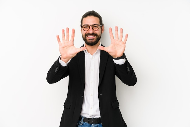 Young caucasian business man isolated on a white background showing number ten with hands.