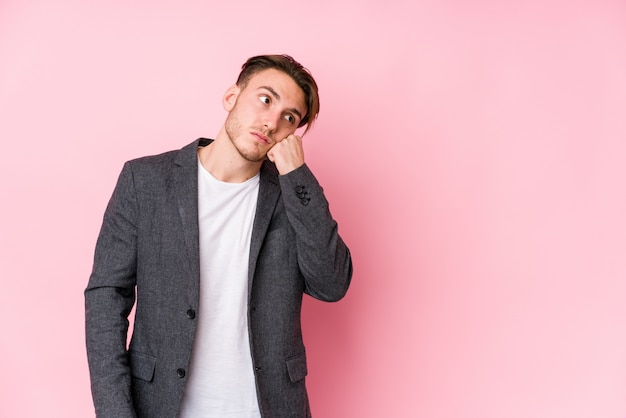 Young caucasian business man posing isolated who feels sad and pensive, looking at copy space.