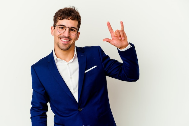 Young caucasian business man showing a horns symbol