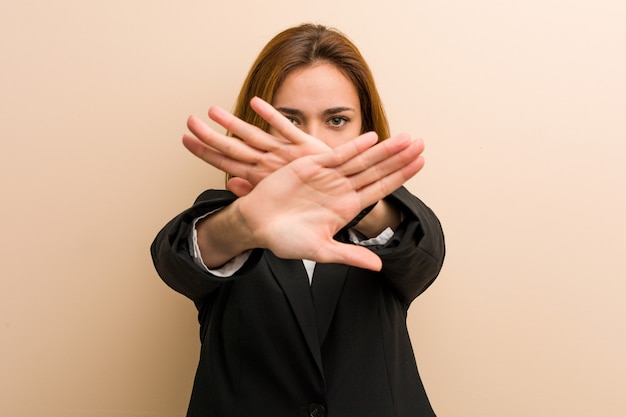 Young caucasian business woman doing a denial gesture