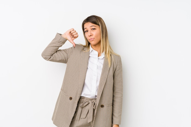Young caucasian business woman isolated showing a dislike gesture, thumbs down. disagreement concept.