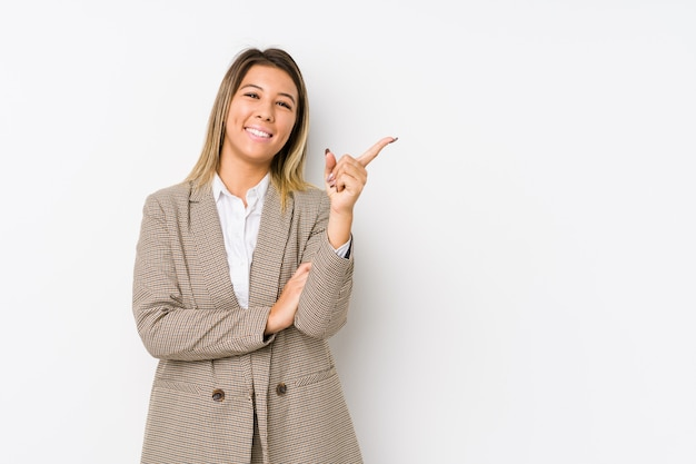 Young caucasian business woman isolated smiling cheerfully pointing with forefinger away.