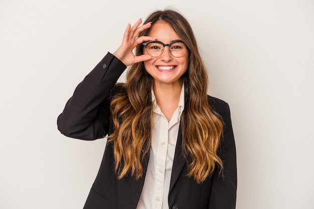 Young caucasian business woman isolated on white background excited keeping ok gesture on eye.