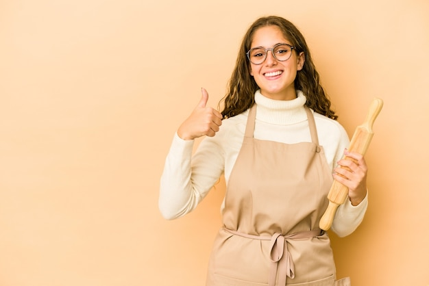 Young caucasian chef woman isolated smiling and raising thumb up