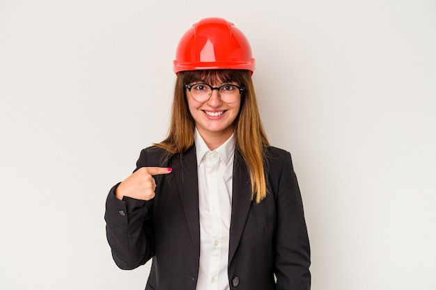 Young caucasian curvy architect woman isolated on white background person pointing by hand to a shirt copy space, proud and confident