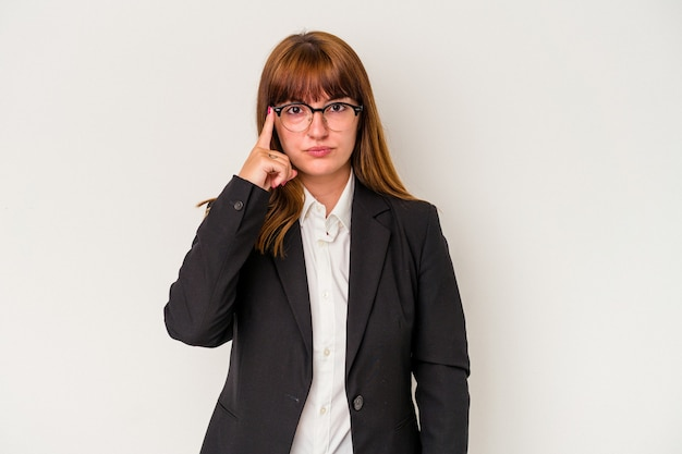 Young caucasian curvy business woman isolated on white background pointing temple with finger, thinking, focused on a task.