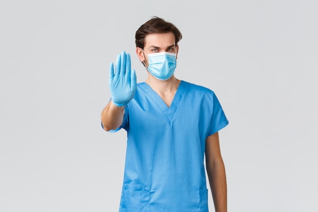Young caucasian doctor with mask in pandemic virus