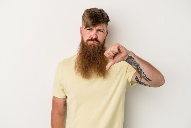 Young caucasian ginger man with long beard isolated on white background showing thumb down, disappointment concept.