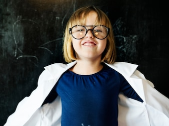 Young caucasian girl cheerful with chalk board background