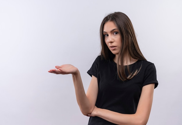 Young caucasian girl wearing black t-shirt raising hand on isolated white wall