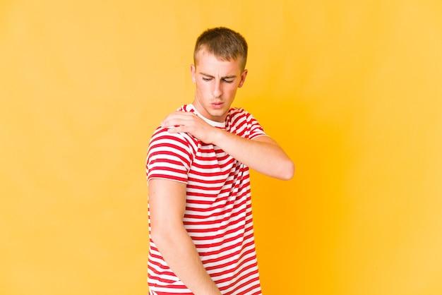Young caucasian handsome man having a shoulder pain.