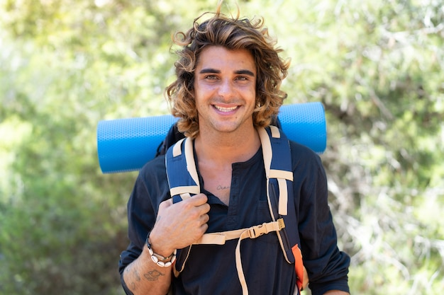 Young caucasian hiker man spending their camping vacations