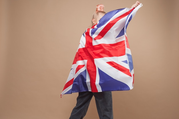 Young caucasian hipster woman with flag of britain