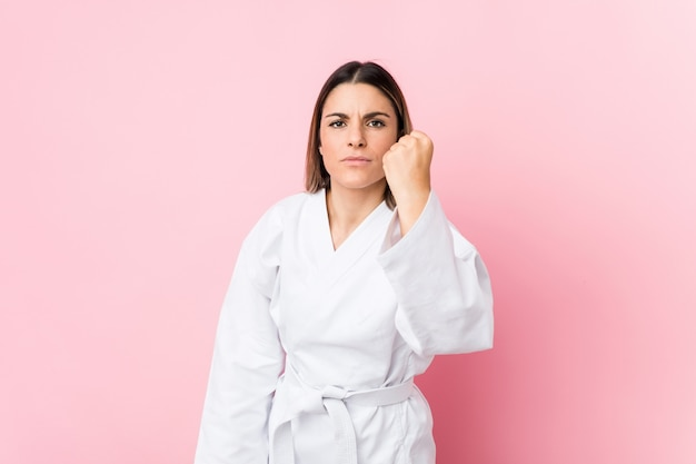 Young caucasian karate woman isolated
