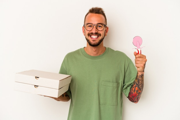 Young caucasian man holding pizzas