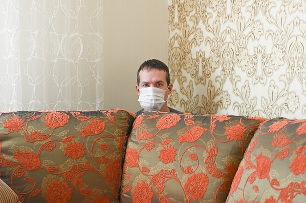 Young caucasian man is messing around at home. quarantine concept.
