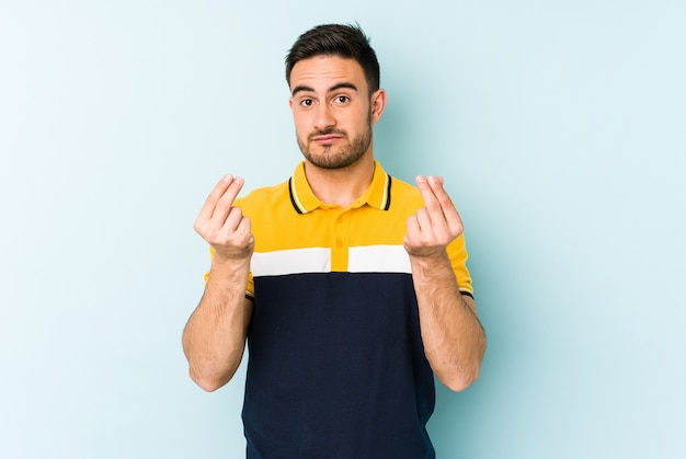 Young caucasian man isolated on blue background showing that has no money.