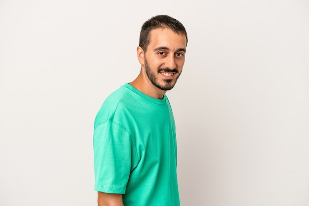 Young caucasian man isolated on white background confident keeping hands on hips.
