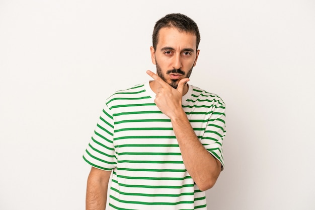 Young caucasian man isolated on white background contemplating, planning a strategy, thinking about the way of a business.