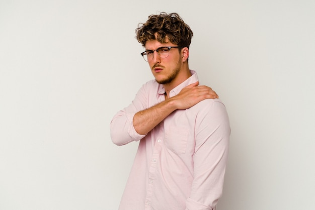 Young caucasian man isolated on white background having a shoulder pain.