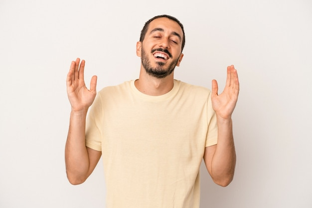 Young caucasian man isolated on white background joyful laughing a lot. happiness concept.