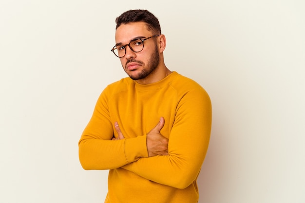Young caucasian man isolated on white background unhappy looking in camera with sarcastic expression.