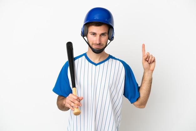 素晴らしいアイデアを指している白い背景で隔離の野球をしている若い白人男性
