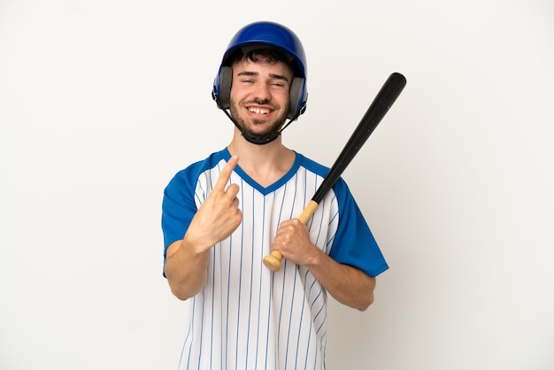 Young caucasian man playing baseball isolated on white background doing coming gesture