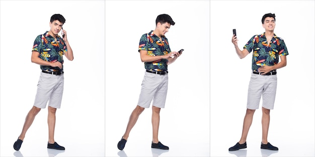 Young caucasian man in summer tropical printed polo shirt black short stand and walk in smile happy action with using smart mobile phone, white background isolated, full length collage group concept
