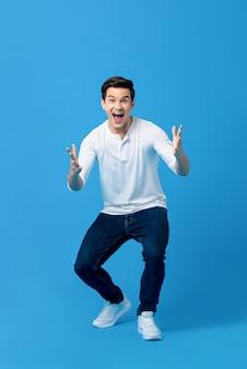 Young caucasian man in surprised gesture