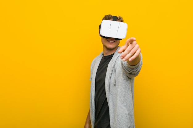 Young caucasian man using a virtual reality glasses
