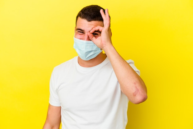 Young caucasian man wearing a protection for coronavirus isolated