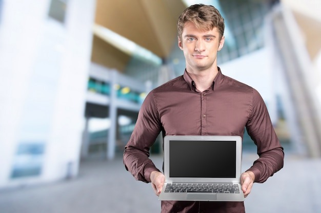 Young caucasian man with portable pc in his hands