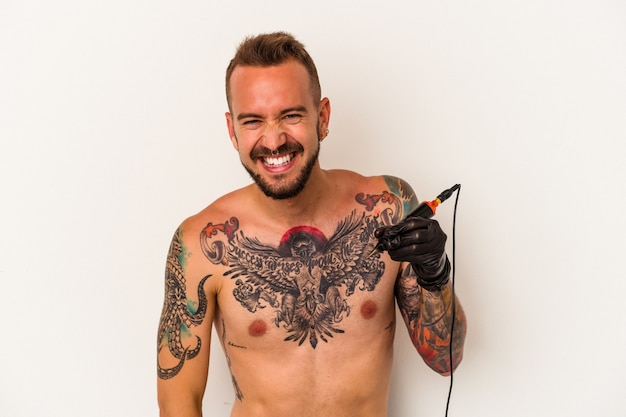 Young caucasian man without t-shirt isolated on white background  laughing and having fun.