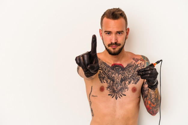 Young caucasian man without t-shirt isolated on white background  showing number one with finger.