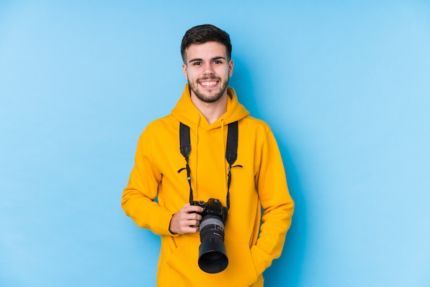 Young caucasian photographer man isolated happy, smiling and cheerful.