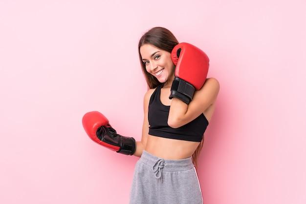Young caucasian sporty woman boxing