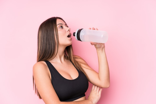 Young caucasian sporty woman holding a water bottle