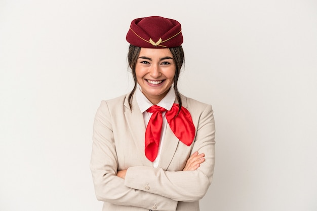 Young caucasian stewardess woman isolated on white background laughing and having fun.