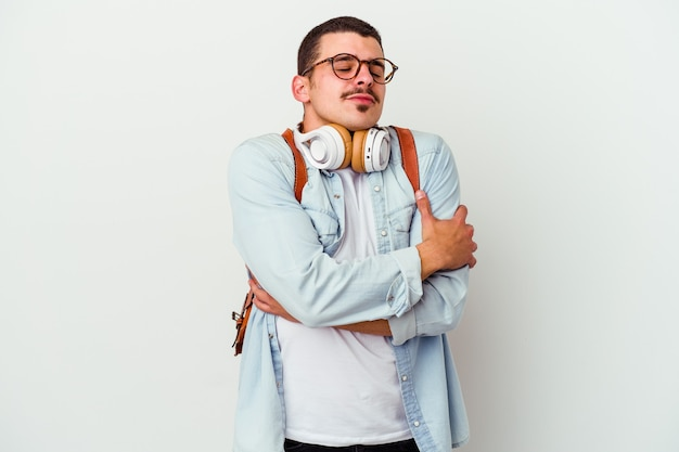 Young caucasian student man listening to music isolated