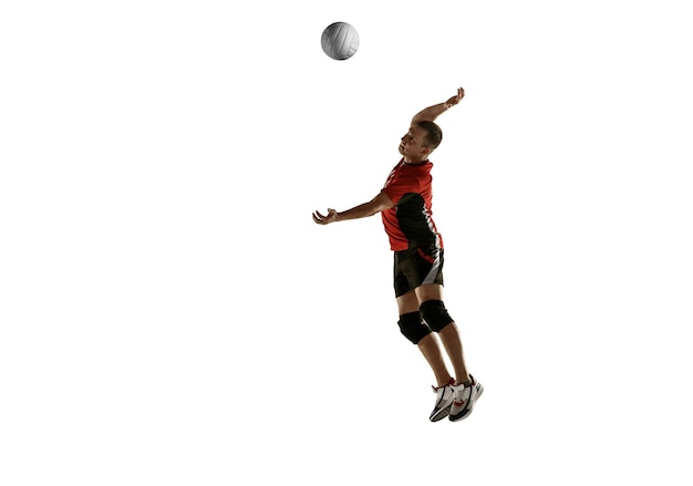 Young caucasian volleyball player placticing isolated on white background