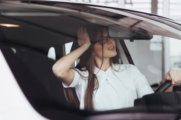 Young caucasian woman in a car