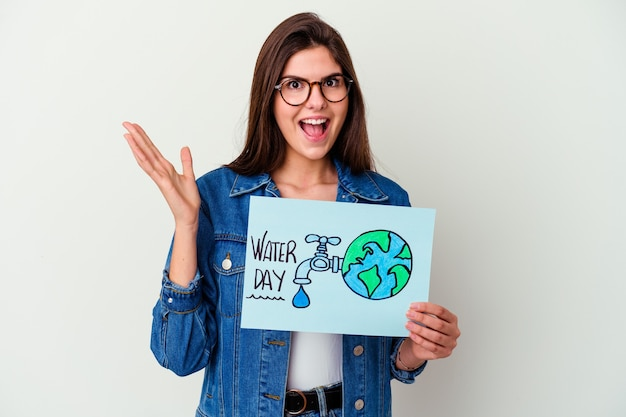 Young caucasian woman celebrating world water day isolated on pink pointing to the side