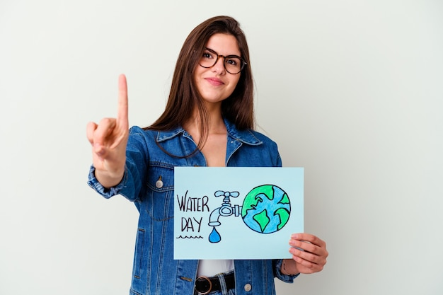 Young caucasian woman celebrating world water day isolated on pink smiling and raising thumb up
