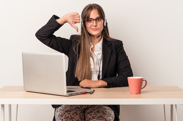 Young caucasian woman doing telecommuting isolated on white background showing a dislike gesture, thumbs down. disagreement concept.