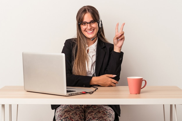 Young caucasian woman doing telecommuting isolated on white background showing number two with fingers.